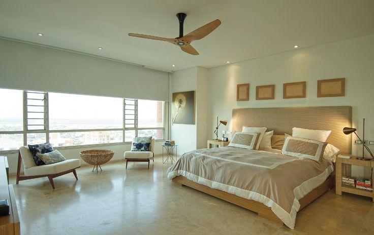 FRESCA HABITACIÓN que parte del tono del piso, marmol Sinea mate, y del espaldar diseñad por Jorge Lizarazo en organza, hilos de cobre y bronce blanco.