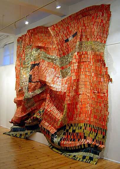 El Anatsui (Ghana), Flag for a New World Power, 2004. Aluminium and copper wire, 500 x 550 cm.  Anatsui converts found materials into art that lies somewhere between sculpture, mosaics and painting.