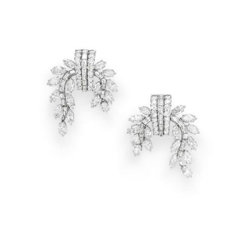 A PAIR OF DIAMOND EAR PENDANTS, BY HARRY WINSTON   Each designed as a circular-cut diamond tapered panel with a central row of baguette-cut diamonds, extending marquise and baguette-cut diamond hinged branches, mounted in platinum  Signed Winston for Harry Winston