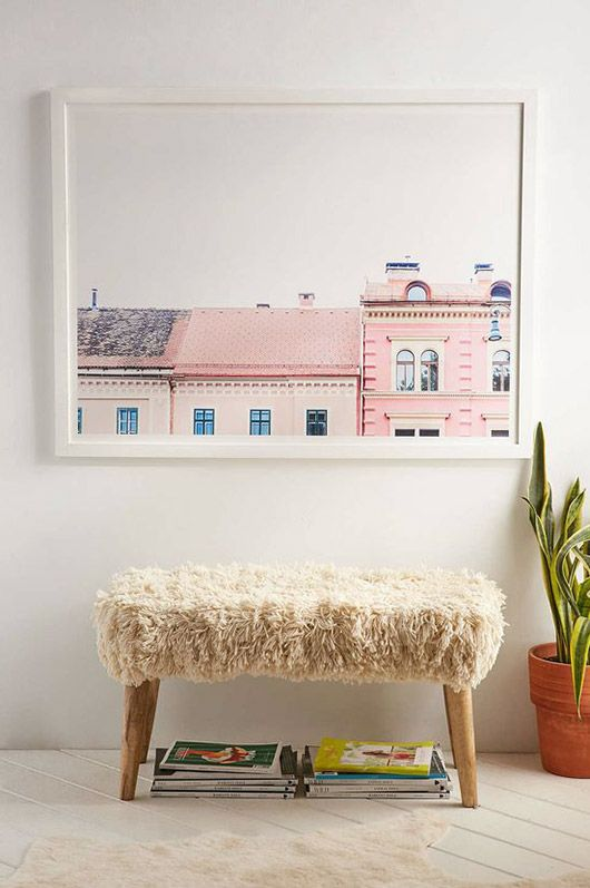 large photograph of pink buildings over bench with fur throw / sfgirlbybay