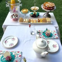 A Royal afternoon tea for children. Doilies, savoury and sweet treats. Union Jack mugs, peppermint tea