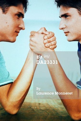DA23331-twin-teenage-boys-arm-wrestling-profile-gettyimages.jpg (339×505)