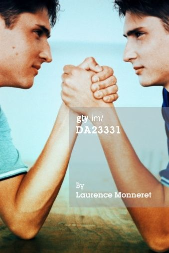 DA23331-twin-teenage-boys-arm-wrestling-profile-gettyimages.jpg (339×505)