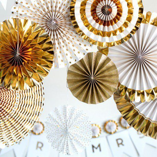 These paper pinwheel decorations are sure to make the perfect playful statement at your wedding.