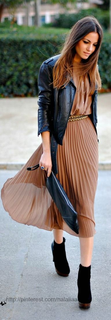 Oh this is gorgeous. Champagne colored pleated dress with a black leather jacket + simple accessories.
