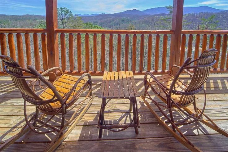 Picture-perfect - Both decks, which span the width of the cabin, look out over the woods toward the Great Smoky Mountains. You might spy falcons or eagles soaring across the seemingly endless sky.