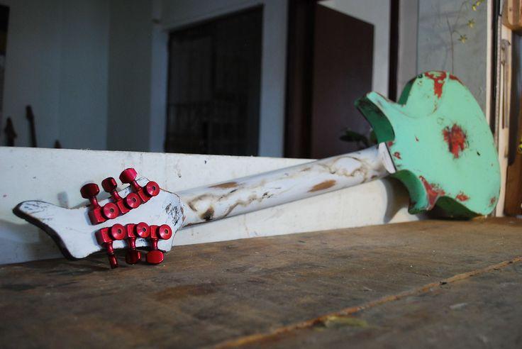 "Raccoon by Distorted Branch Custom GuitarsMahogany body  Set-in mahogany neckRosewood fretboardNickel Silver fretsc shapeHot P-90 Seymour Duncan pickupSperzel tunersGotoh BridgeVol3 way switch tone25.5"" scale24 frets16"" radius Walnut custom knobs"