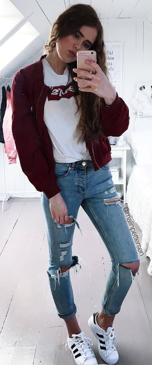 cool street style outfit bomber jacket + top + rips