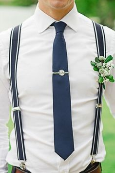Groomsman with navy blue suspenders