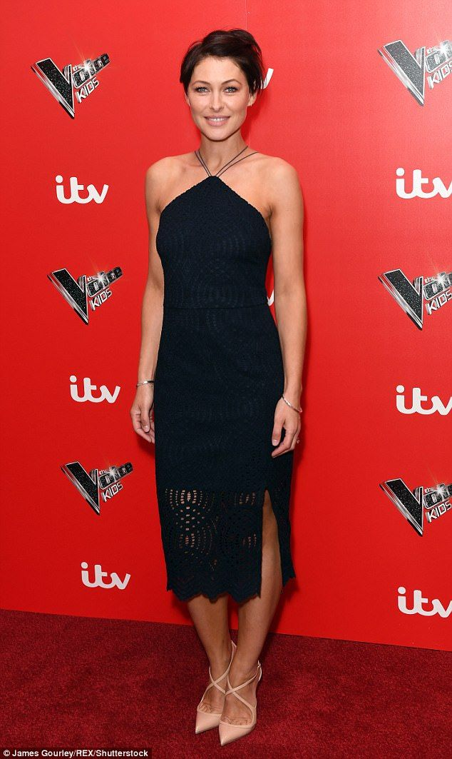 Chic: Emma looked effortlessly elegant in a simple black dress with a halterneck cut...