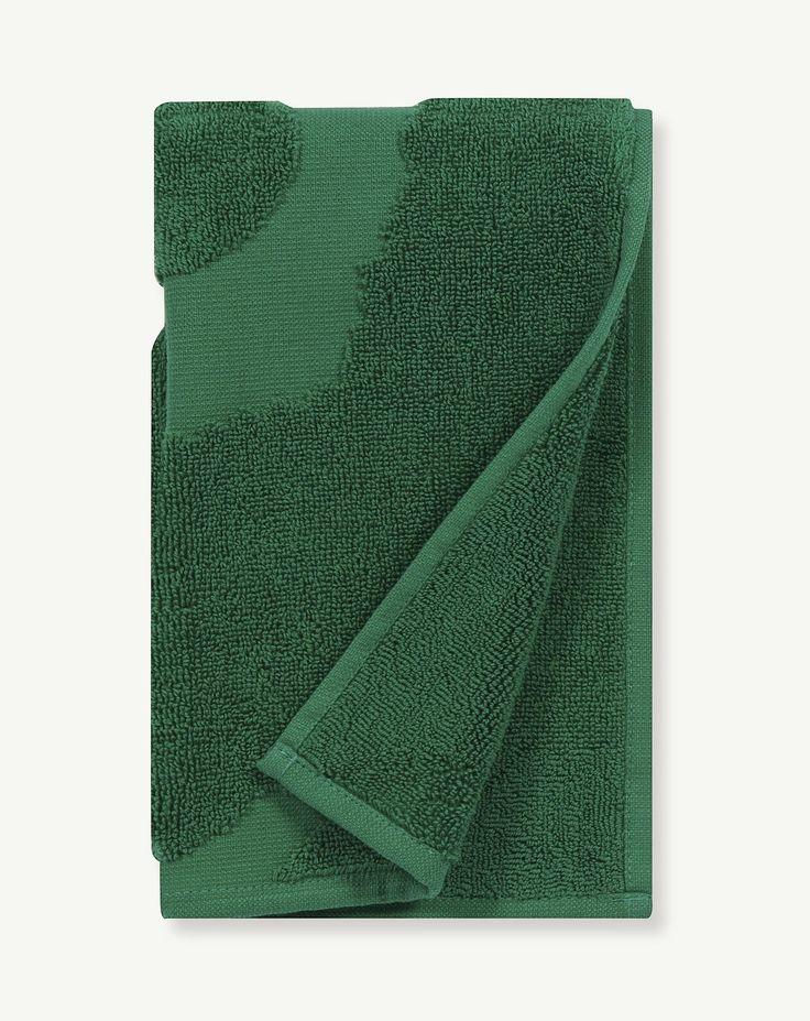 Grønne håndklæder fra Marimekko i serien Unikko Pinta
