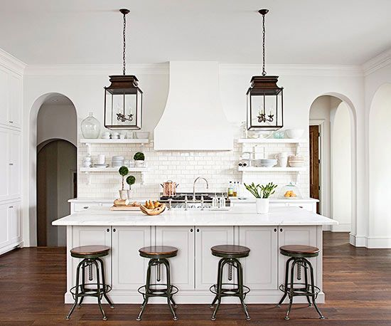 Rich accents add warmth to this crisp, open kitchen! Get the look here: http://www.bhg.com/kitchen/color-schemes/neutrals/white-kitchen-design-ideas/?socsrc=bhgpin030115richaccents&page=6