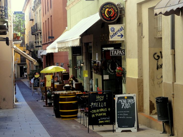 Narrow streets and cafe terraces of Figueres.