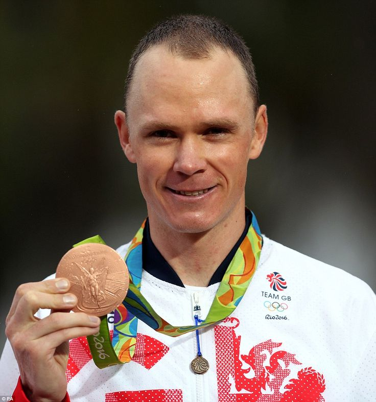 Third place: Chris Froome has won bronze in the cycling time trial just weeks after winning the Tour de France...*A*