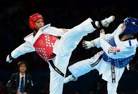 Paige McPherson (left) wins Bronze medal in Women's Taekwondo.