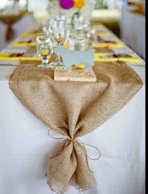 Tie the end of the burlap table runner with twine.  Oh so simple for a beautiful yet rustic touch for your Thanksgiving table.