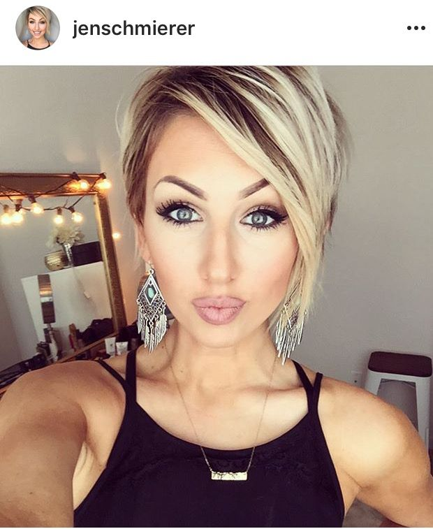 This woman is gorgeous....her make-up is perfect and her hair is the perfect cut, color, and style for her.