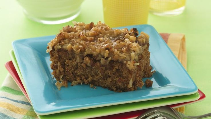 This delicious oatmeal cake topped with coconut and nuts mixture is perfect for anytime dessert.