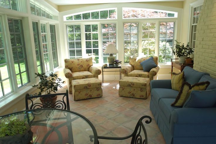 sunroom designs | Sunroom renovation long view of completed and furnished room and ...