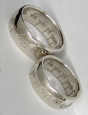 """The previous pinner said: """" Wedding rings! The elvish engraving says: """"One ring to show our love, one ring to bind us, one ring to seal our love and forever entwine us."""" """" - I love these, I'd so have them for my own... only problem is the physical size, as these look pretty thick. :\"""