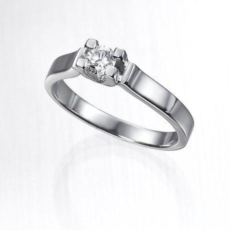 Anillo solitario de diamantes VENUS  Anillo solitario con diamante central talla brillante engastado en una montura de oro de 18 kilates de cuatro garras y brazos planos.