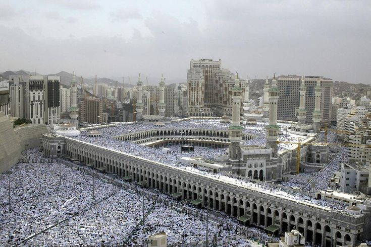 Muslims pray 23 January 2004 at the Grand Mosque in the holy city of Mecca ahead of the hajj, which begins on January 30.