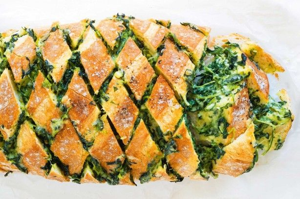 Just score and stuff for this clever cheesy pull-apart take on a classic spinach cob loaf dip.