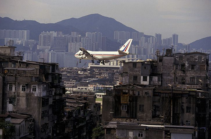 Kai Tak airport, Kowloon: a plane approaching the airport in 1992. The airport closed in 1998