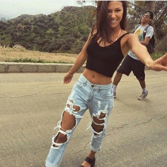 Black top with ripped boyfriend jeans