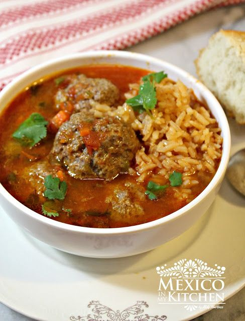 There are several ways to make a Mexican meatball soup, and this is one of the simplest recipes that I've found that my family absolutely loves. These Mexican Meatballs are cooked in a tomato broth flavored with cilantro. A delicious and elegant dish that's perfect for a nice dinner.