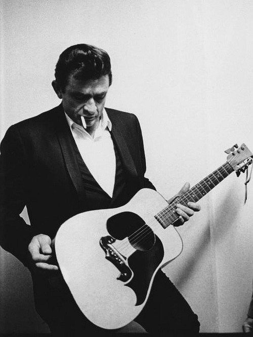 Interesting picture of Johnny Cash with a unusual guitar. He doesn't seem to know what to make of it...