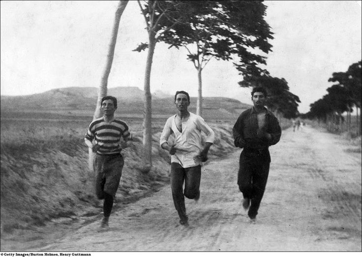 The photo was taken during the test of the marathon of the first modern Olympic Games, in Athens in 1896. The athlete, in the Middle, is Harilaos Vasilakos, student of Athens (1877-1964), who finished second behind his compatriot, Spyridon Louis (1873-1940). Two weeks earlier, Vasilakos had won the gold medal in the marathon at the 1st Panhellenic games, March 10, 1896.