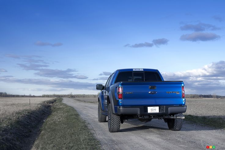 driving away 2012 blue Ford Raptor ( 2012)