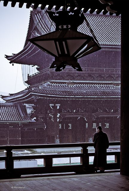 Pensive monk shelters from the rain - Nishi Honganji temple, Kyoto beautiful Japan travel Asian