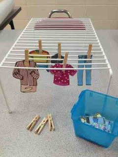 This activity is great for fine motor skills and emphasizes a real life skill. The hanging rack is a closet shoe rack. Use pictures of clothing or print out from the internet.