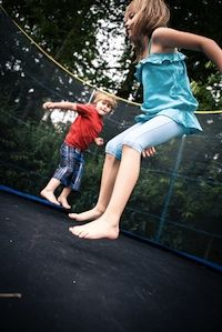The trampoline is a backyard fixture for many American families; however, their popularity doesn't mean that they're completely safe. For parents that are considering giving in to the begging, pleading and bargaining from their kids by getting them a trampoline, here are a few things to think about.