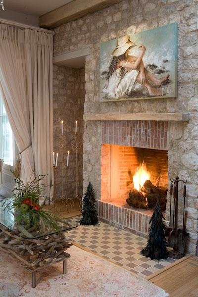 The stone walls go so well with this cosy fireplace made with lanes ceramics klompie bricks