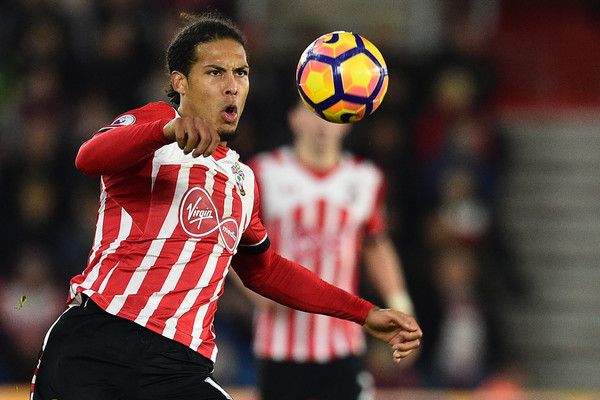 Southampton's Dutch defender Virgil van Dijk controls the ball during the English Premier League football match between Southampton and Everton at St Mary's Stadium in Southampton, southern England on November 27, 2016. / AFP / Glyn KIRK / RESTRICTED TO EDITORIAL USE. No use with unauthorized audio, video, data, fixture lists, club/league logos or 'live' services. Online in-match use limited to 75 images, no video emulation. No use in betting, games or single club/league/player…