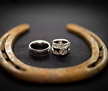 Take a photo of your wedding rings inside a horseshoe