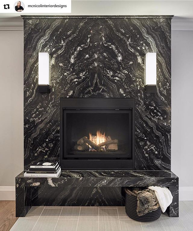 Stunning bookmatched fireplace supplied by @MarbleTrend using Nero Fiume granite bookmatched   #Repost @mcnicolinteriordesigns This fireplace is the first thing you see when walking toward the back of the Sonley Project. It used to be half the height with a small window above it. It was awkward and unsightly. The contractor closed the window off from the inside (its atill seen on the outaide of the house) so that we could make this a feature. We raised the gas insert to add fit a hearth…