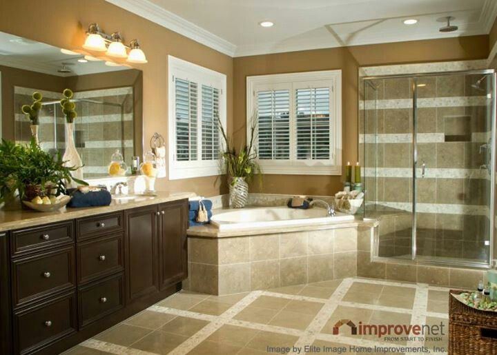 Photo Album Gallery A cohesive luxury bathroom design with soaker tub glass shower and dark wood vanity