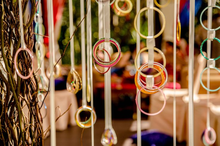 Bangles hanging as a backdrop for a mendhi night would be beautiful!