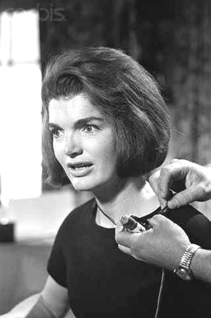 Jacqueline Kennedy Having Wires Adjusted  Hyannisport, Mass.: Mrs. Jacqueline Kennedy appears excited as she establishes voice contact with British Prime Minister Harold MacMillan during rehearsal of special CBS live transatlantic news program on the occasion of the late President's birthday.  Date:May 29, 1964 ❤❃❤❃❃❤❃❤ http://en.wikipedia.org/wiki/Jacqueline_Kennedy_Onassis