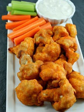 Cauliflower Buffalo Wings.  A great snack and filling. My friend and I both made these and frozen cauliflower (thawed) was the easiest and less messy. A co worker thought it was buffalo chicken at first!