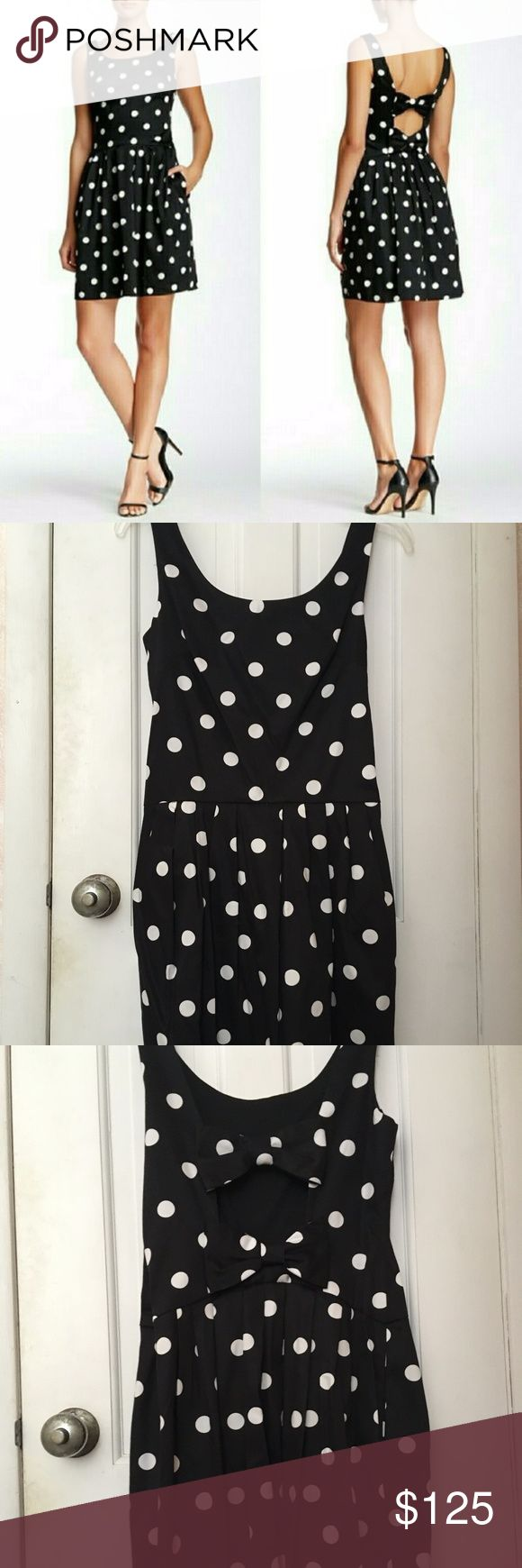 Betsey Johnson Black & White Polka Dot Dress (NWT) Brand new dress, with tags.  Thoughtfully designed polka-dot summer dress with an open back broken up by two oversized bows - too cute!  The skirt is pleated but still hugs the legs somewhat (not totally a-line).  A bit too large for me.  New, unworn condition.  Shell: 97% cotton, 3% spandex   Lining:100% polyester  Dry Clean Betsey Johnson Dresses