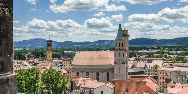 Zittau and its mountains. On the left you see the tower of Zittau City Hall. St. Johannis in the centre of the pic. #StadtZittau