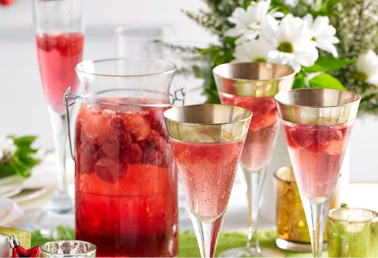 Frozen watermelon balls are used in place of ice cubes in this festive holiday cocktail featuring moscato and mixed berries.