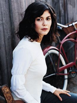 Audrey Tautou. Love the hair and the vintage bike in the background :)
