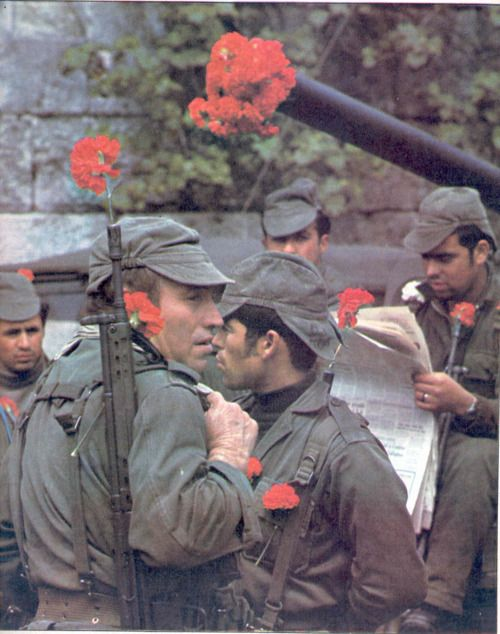 "This was in Portugal. April 25th 1974, ""A Revolução dos Cravos"" (The Carnation Revolution), The Day of Freedom.    ""The name ""Carnation Revolution"" comes from the fact no shots were fired and when the population started descending the streets to celebrate the end of the war in the colonies, carnation flowers were put on the guns' ends and on the uniforms."""