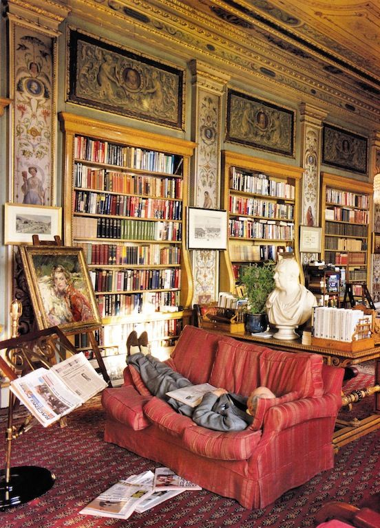 Library at Chatsworth House in Devonshire, England. Love the 11th Duke of Devonshire (Andrew Cavendish) lying on his sofa, fully   suited up.